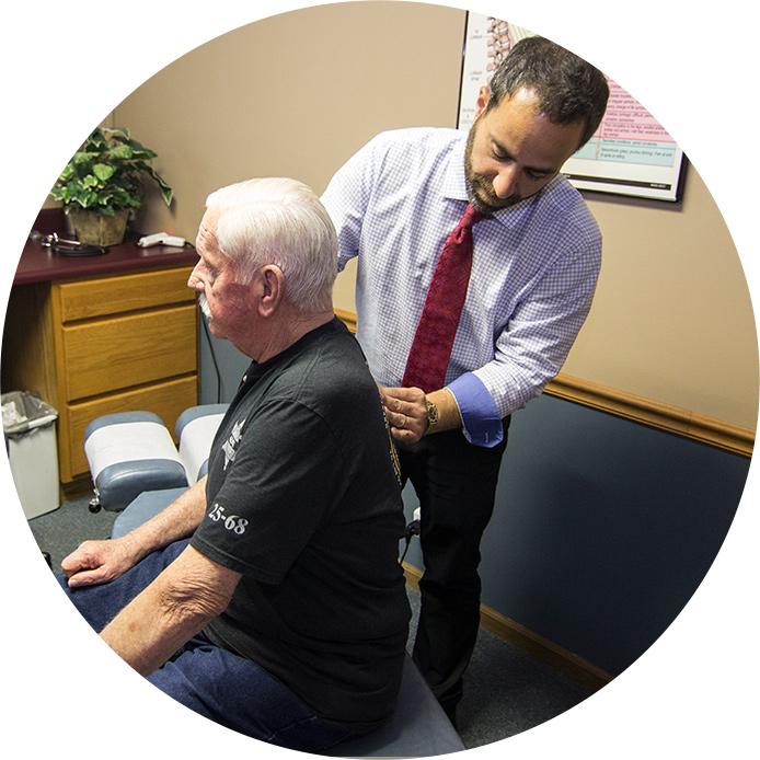 Dr. Holland examining patient