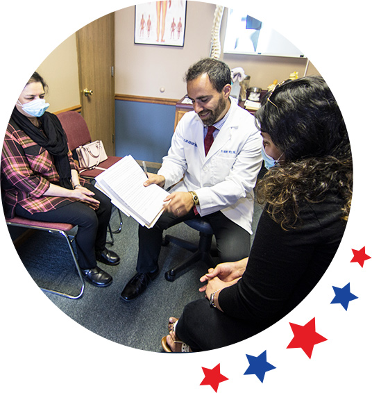 Dr. Holland consulting with patient