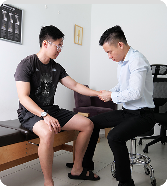 Dr Chen looking at patients arm
