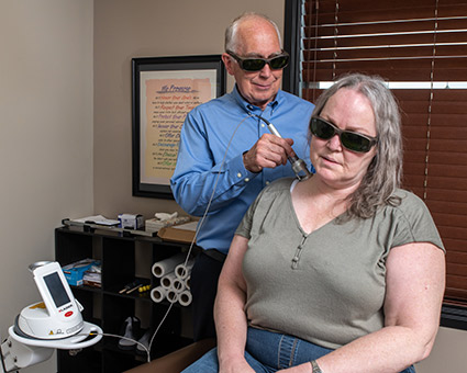 Woman receiving cold laser therapy