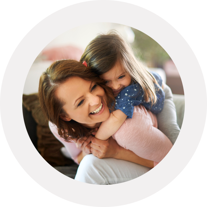 Little girl hugging mom