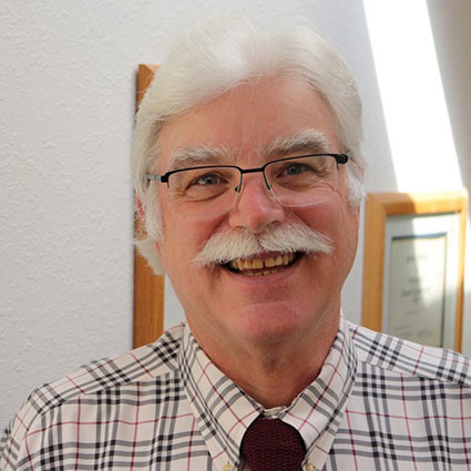 Dr. Baker smiling