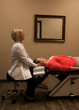 Dr. Jamie adjusting patient