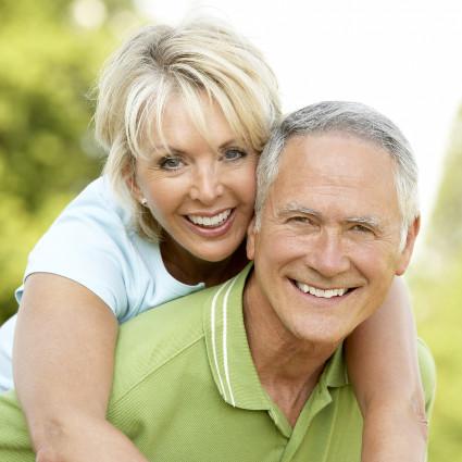 senior couple smiling at park