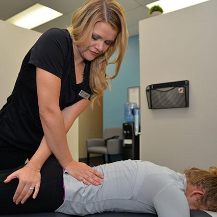 Dr. Lisa adjusting patient
