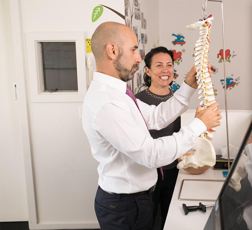 Dr. Mario holding spine model