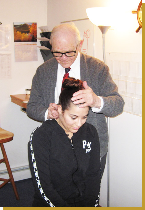 Dr. Dan examining patients neck
