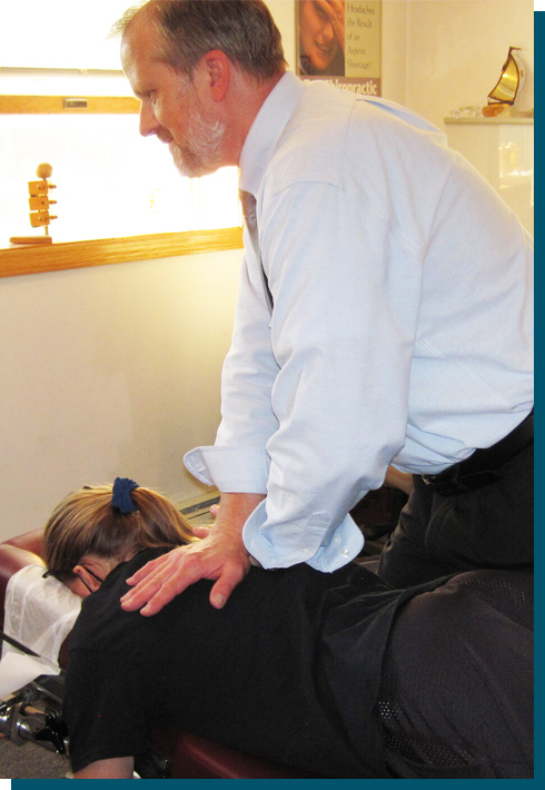 Dr. Mike with hands on patients back