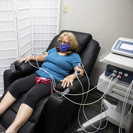 Woman hooked up to machine