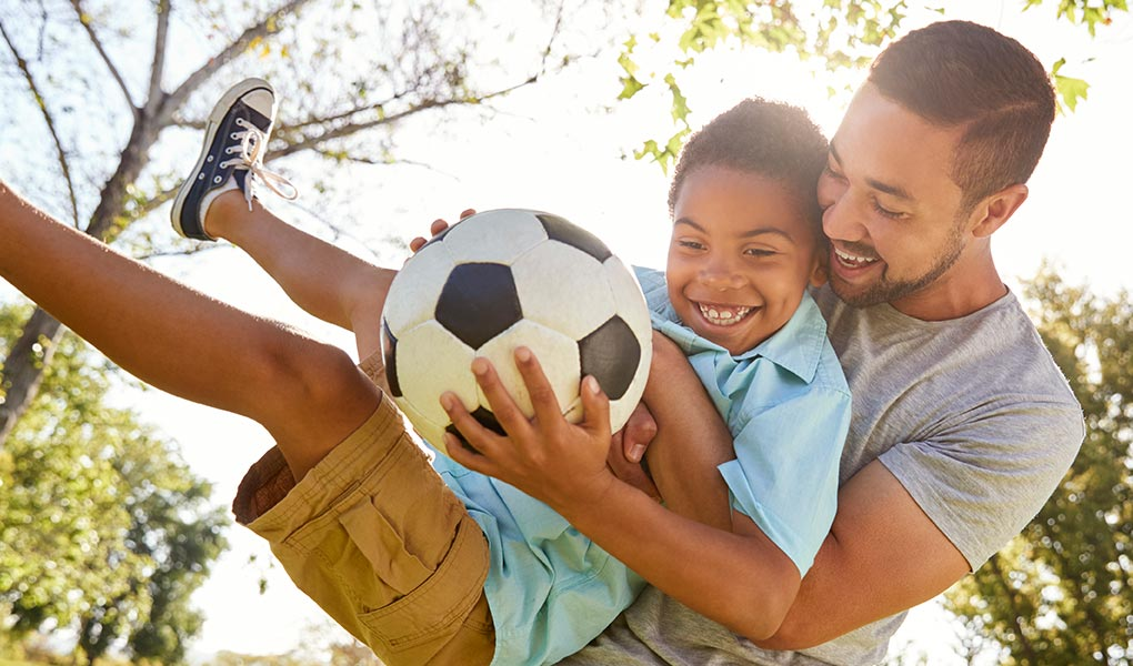 Dad and son with soccer ball