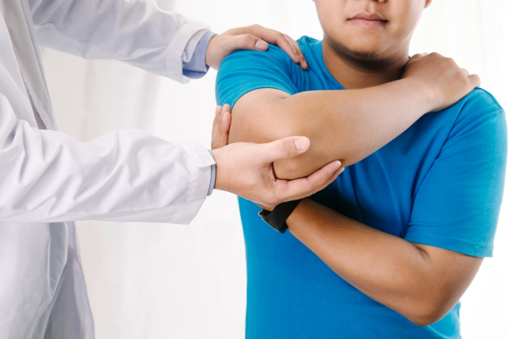 chiropractor-working-on-elbow-and-shoulder