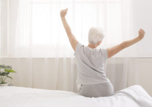 woman-stretching-out-of-bed