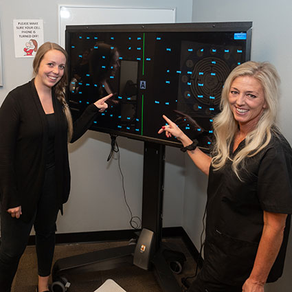 Staff pointing to screen