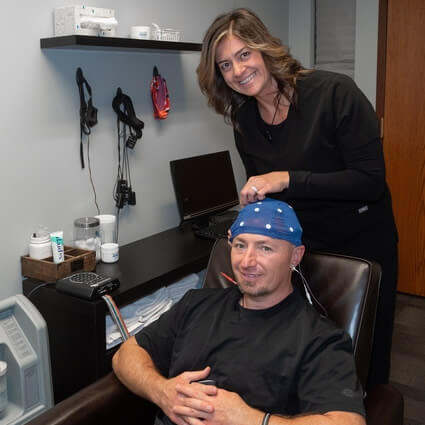 Dr sitting in chair for neurofeedback