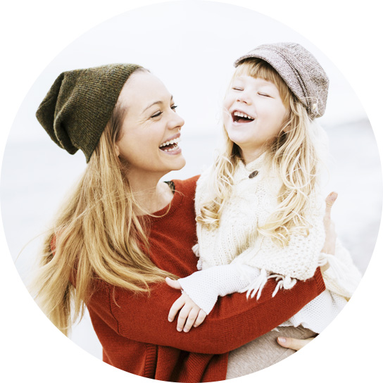 Child and mom laughing