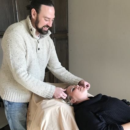 Dr. James applying acupuncture to face