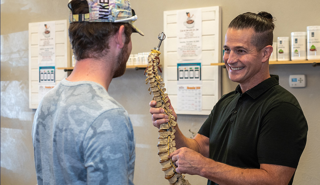Dr. Joe pointing to spine