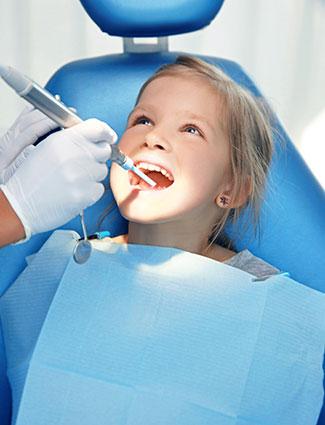 Girl getting teeth clean