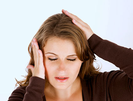 Woman with head and jaw pain