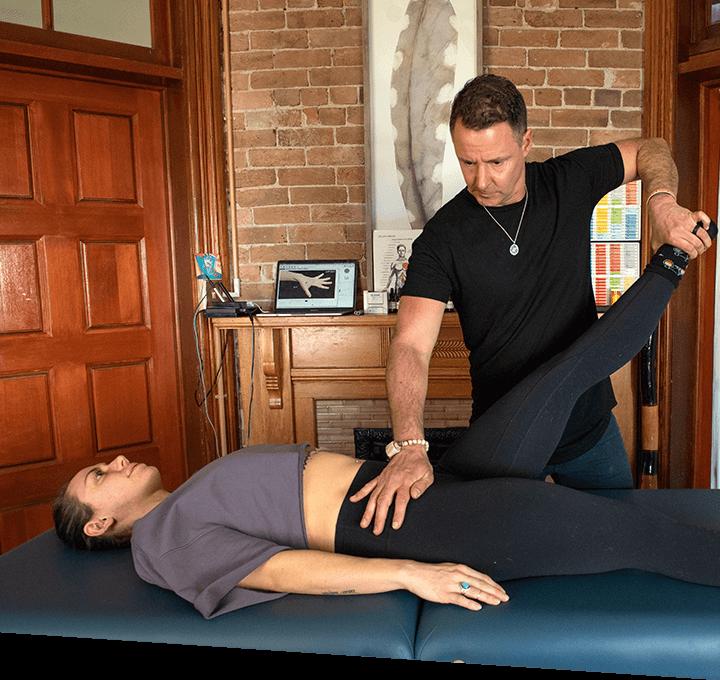 Dr Matt adjusting patients hip