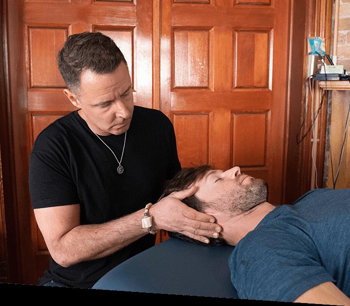 Dr Matt adjusting mans neck