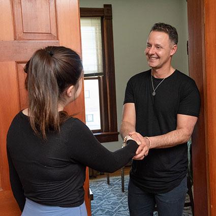 Dr Matt shaking womans hand