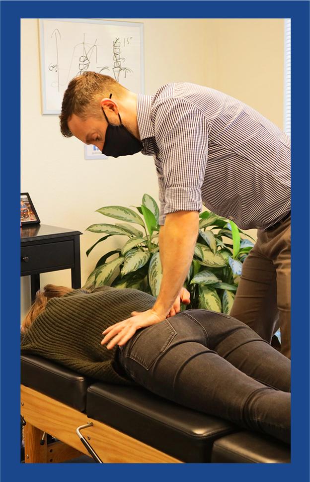 Dr Andrew adjusting womans back