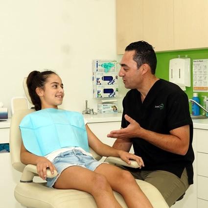 Dentist talking to teeth