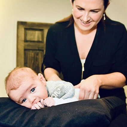 Dr. V adjusting baby