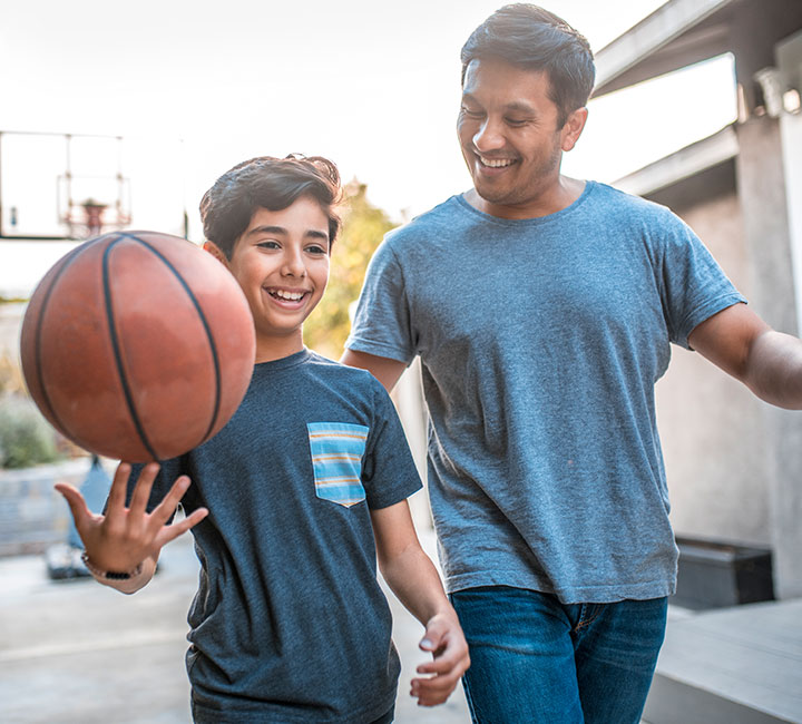 father and son with basketball