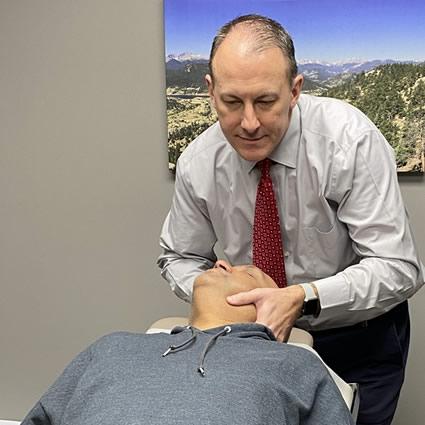 Dr. Ryan adjusting mans neck