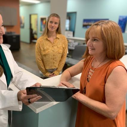 Woman receiving paperwork