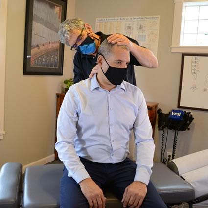 neck adjustment sitting