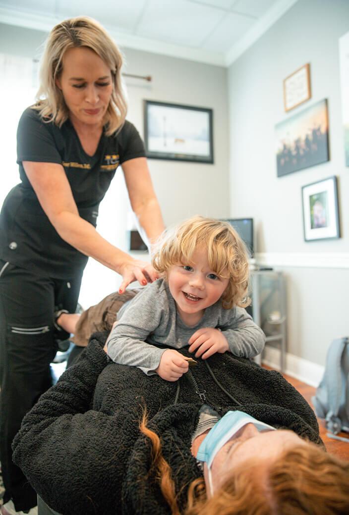 Dr. Jenny adjusting child