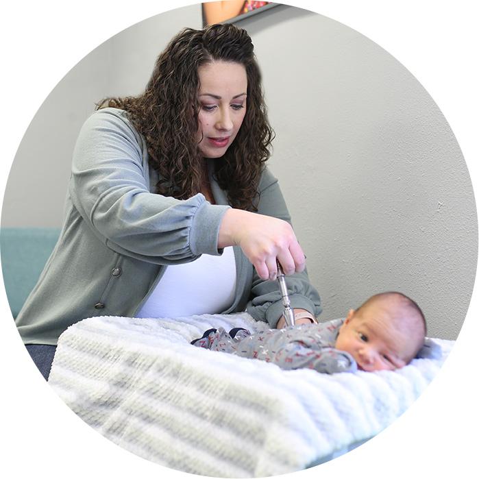 Dr. Katy adjusting baby