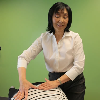 Dr. Siow gently adjusting patient