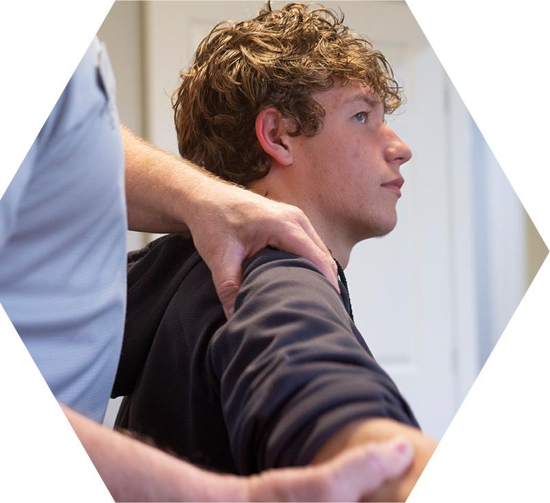 Examining patient shoulder