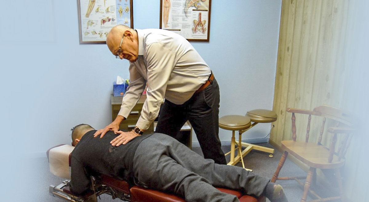 Dr Terry adjusting patient