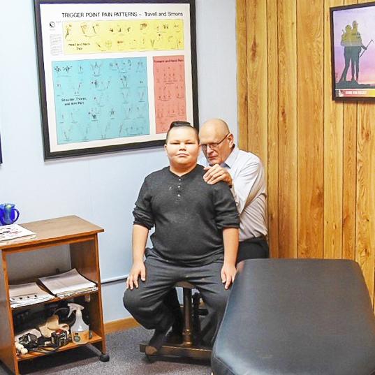 Dr. Terry adjusting child