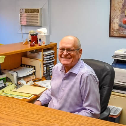 Dr. Terry Setterquist sitting at desk