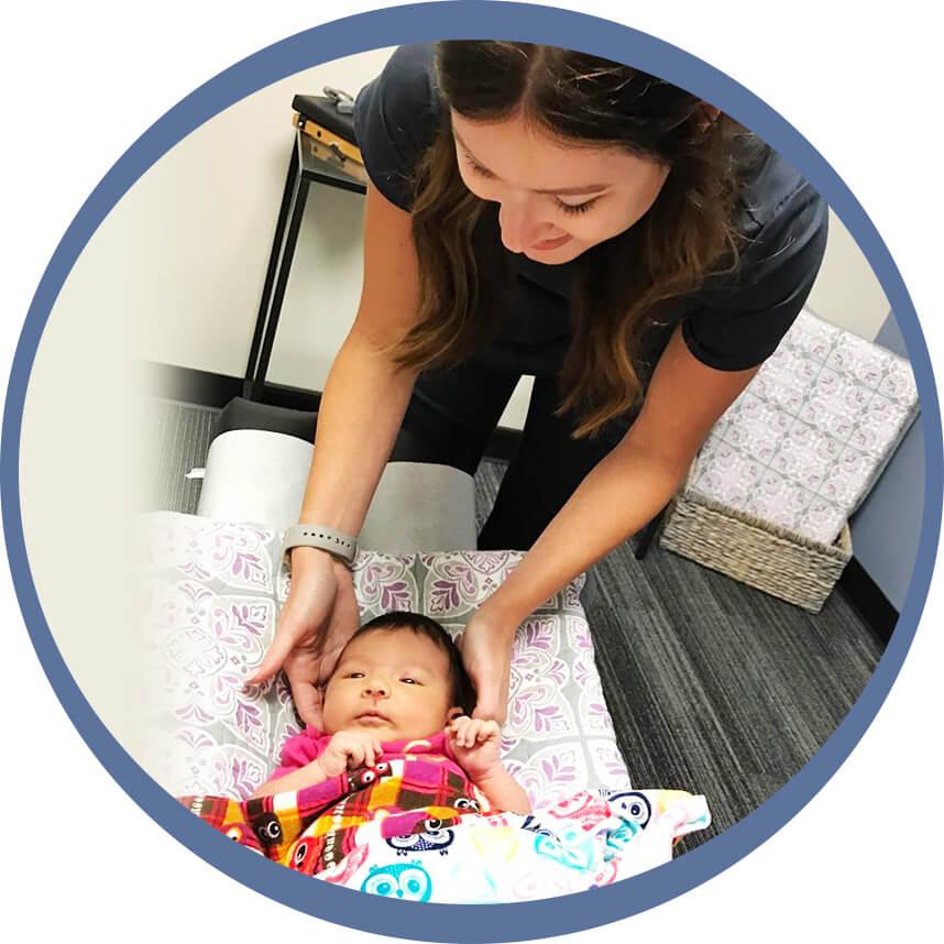 Dr. Lauren adjusting baby's neck