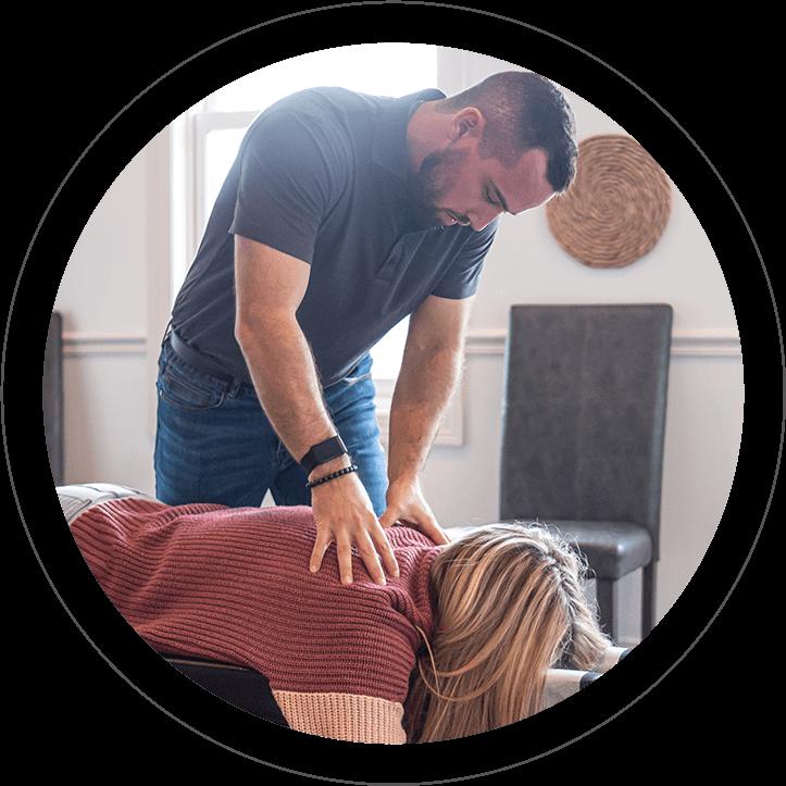 Doctor adjusting patient's back