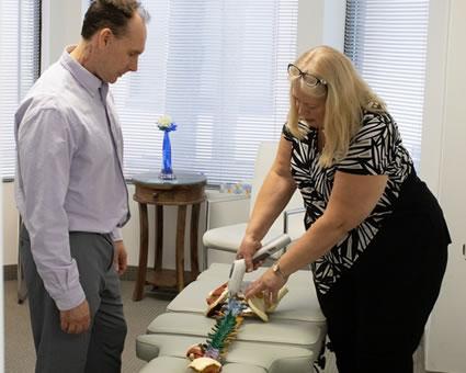 Dr. Andersen demonstrating spine adjustment