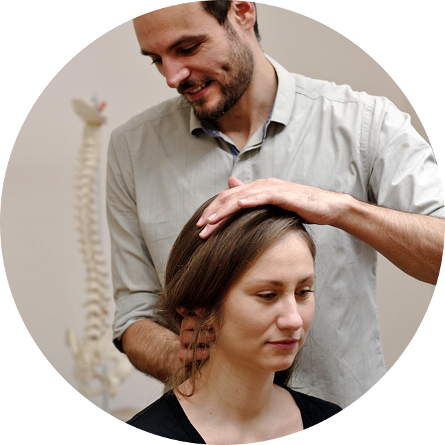 chiropractor adjusting woman's neck