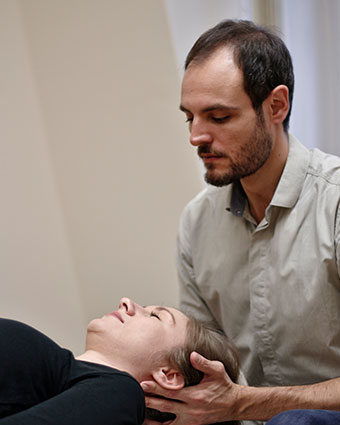 Thiago adjusting woman's neck