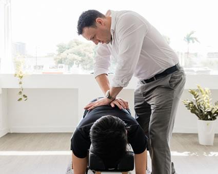 Doctor adjusting man