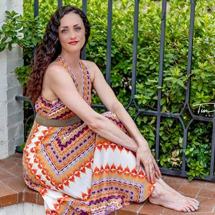 Gabrielle dressed sitting near fence
