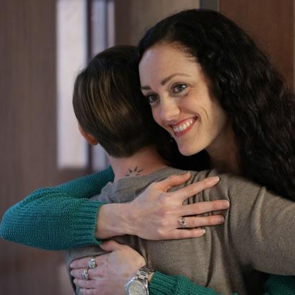 Gabrielle hugging patient