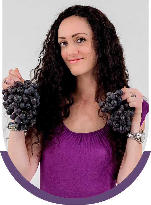 Gabrielle holding grapes