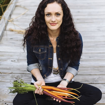 Gabrielle sitting holding carrots